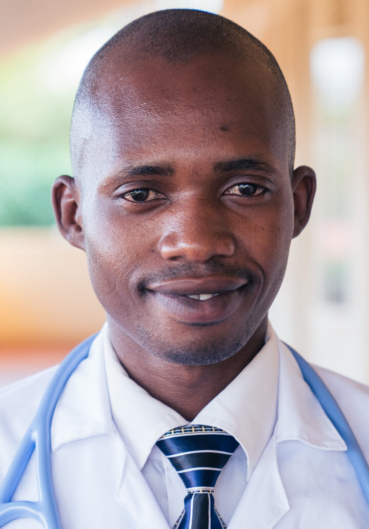 headshot of doctor denis kayumba